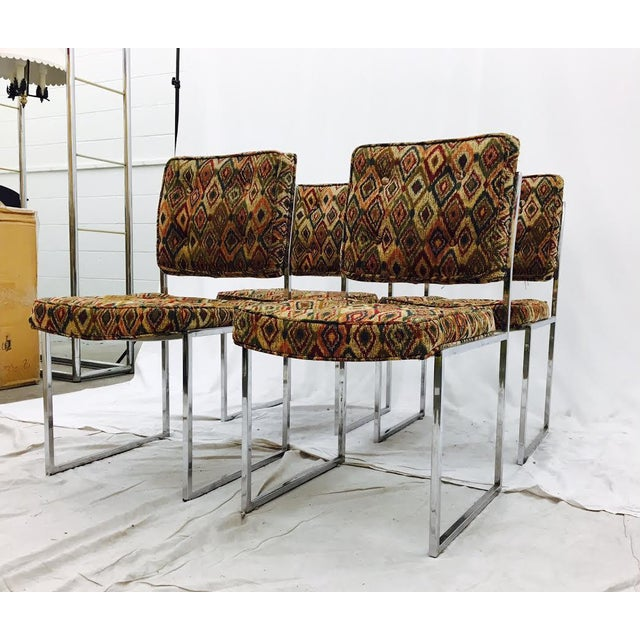 Gorgeous set of 4 mid-century modern chrome framed dining chairs. They have a stunning square profile with a solid and...