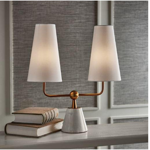 With dramatically elongated shades, the Madison double shade lamp is clean and modern. The brass finish and marble base...