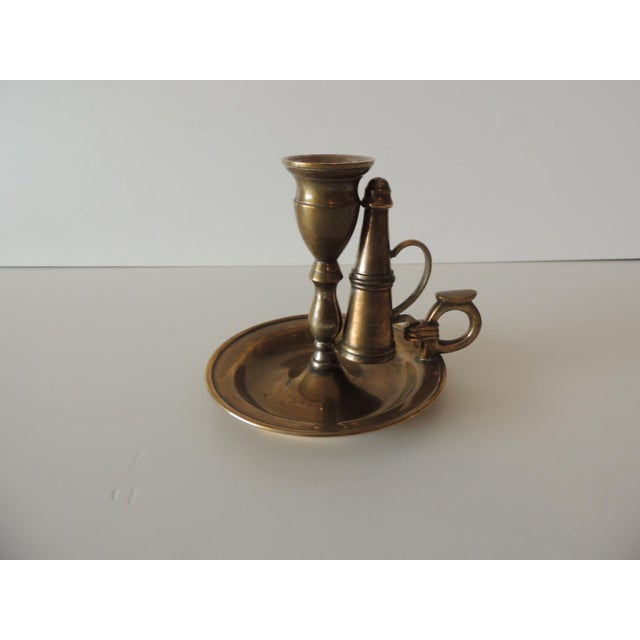 "Vintage brass-plated round candleholder with snuffer. Size: 5.5"" D x 4.75"" W x 4"" H."