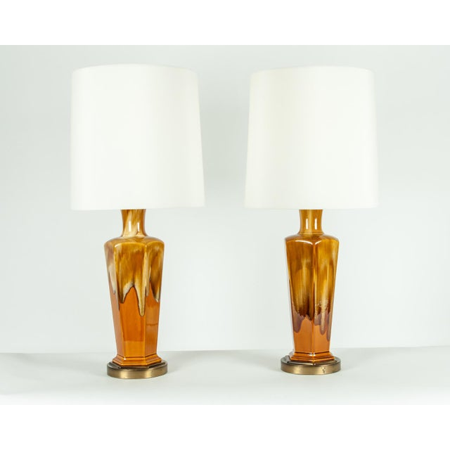 Pair of vintage porcelain table lamps with brass bases. Each lamp is in excellent working condition. Each lamp measure...