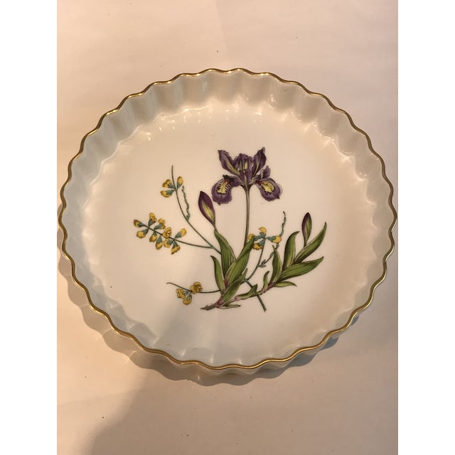 One fluted porcelain tart plate marked on the bottom, SPODE STAFFORD FLOWER IRIS . Measures 9 inches in diameter and 1.5...
