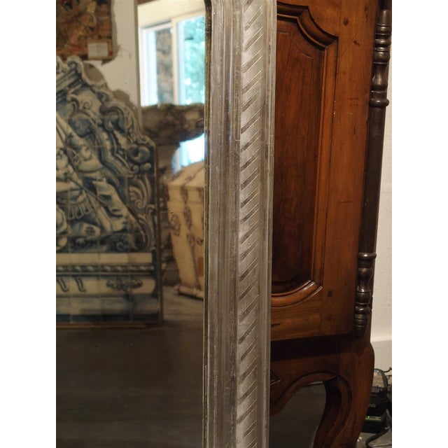 This versatile antique French Louis Philippe has been finished in silver leaf with diagonal rectangles of silver leaf on...