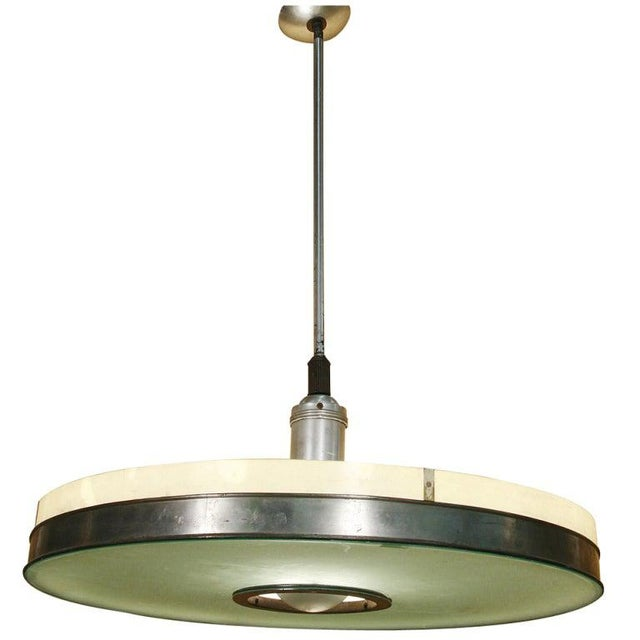 This streamlined aluminum ceiling lamp pair features an original frosted glass shade embellished with a polished aluminum...