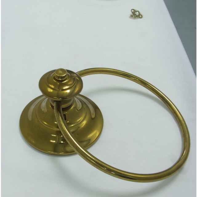 Shiny brass finial towel ring. Very useful and decorative in a bathroom, kitchen, laundry room, cabana etc.