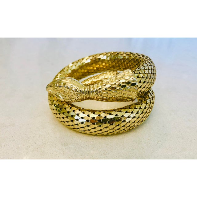 Iconic gold mesh snake bracelet by Whiting & Davis, circa 1980s. Beautifully articulated snake head, bright gold mesh....