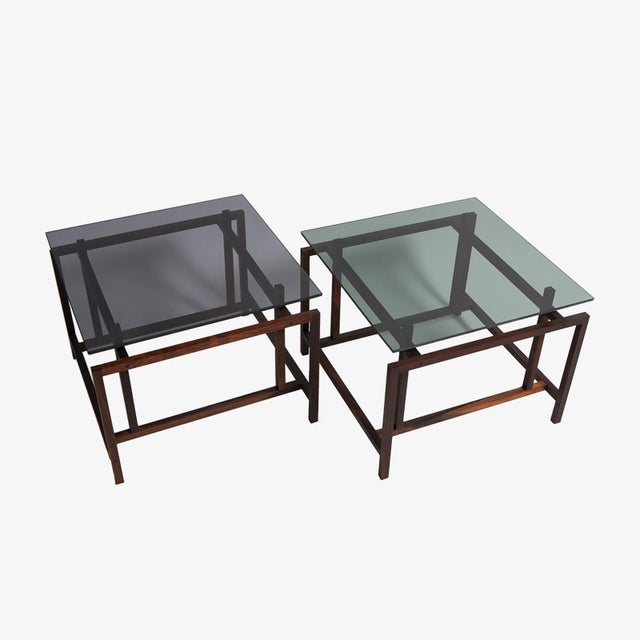 Beautiful pair of old stock, solid rosewood Norgaard side/coffee tables with smoked glass which are no longer in...