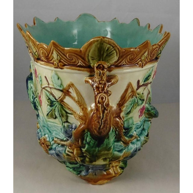 Antique large Majolica jardiniere showing two kingfishers on a pond with aquatics plants and flowers, handles with...