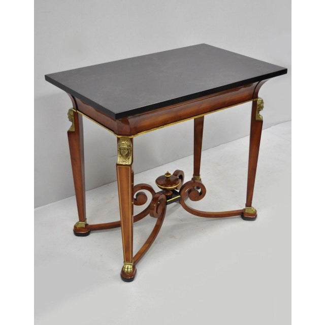 John Widdicomb French Empire style figural bronze mounted occasional lamp table. Item features lacquered faux marble top,...
