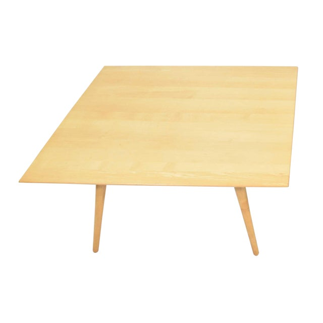We can sell individually. Pair of tables in maple by Paul McCobb. Solid maple top with conical legs.
