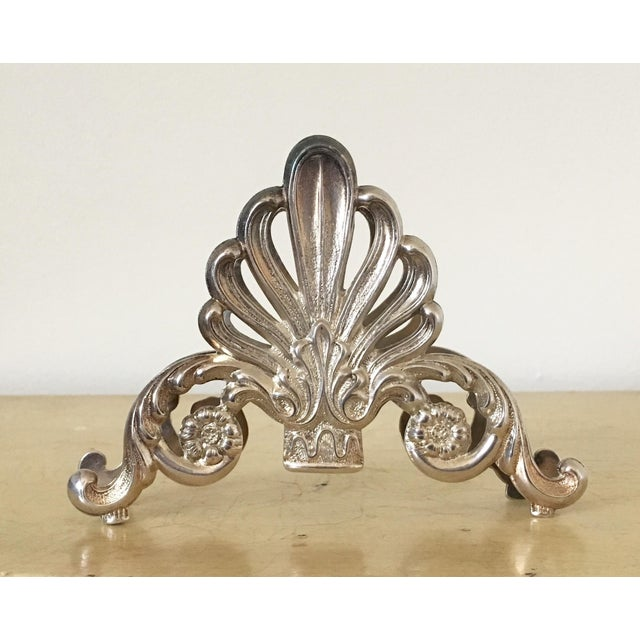Offered is a vintage silver letter holder. Lovely filigree and tarnish. Made in Italy.