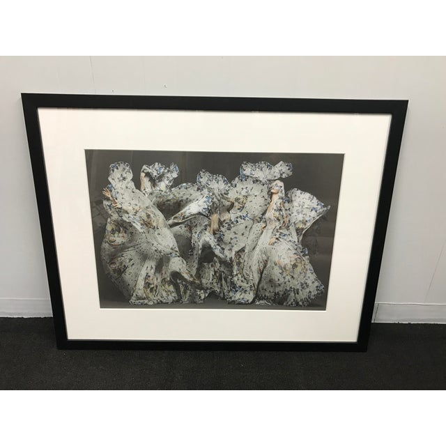 One of a kind custom Alexander McQueen print of three models engulfed in etherial butterfly print fabric. Set in black...