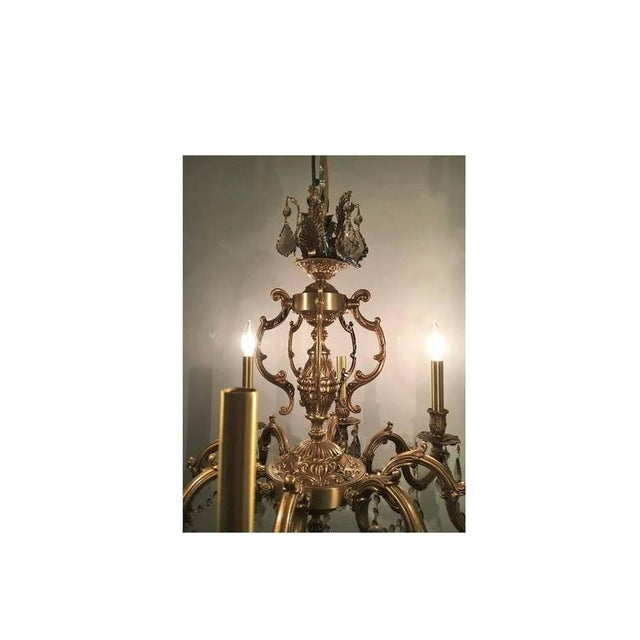 A French brass chandelier with custom Swarvoski crystals. Fine bronze casting. Recently wired and cleaned.