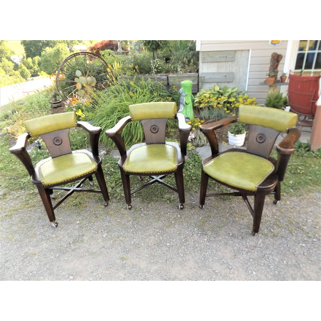 Here's a pretty cool old set of 3 Mid-Century arm chairs. These would be perfect with a round kitchen table. Made of very...