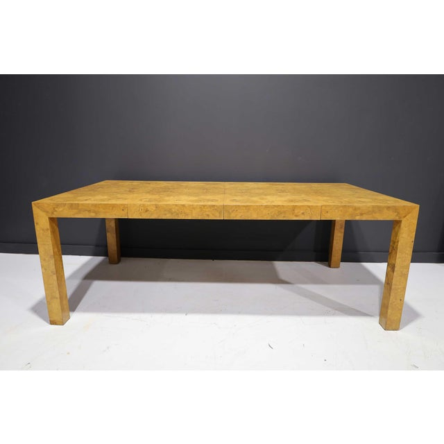 A beautiful olivewood burl dining table by Milo Baughman. Clean lines, great figurative burl book matched expertly. Table...