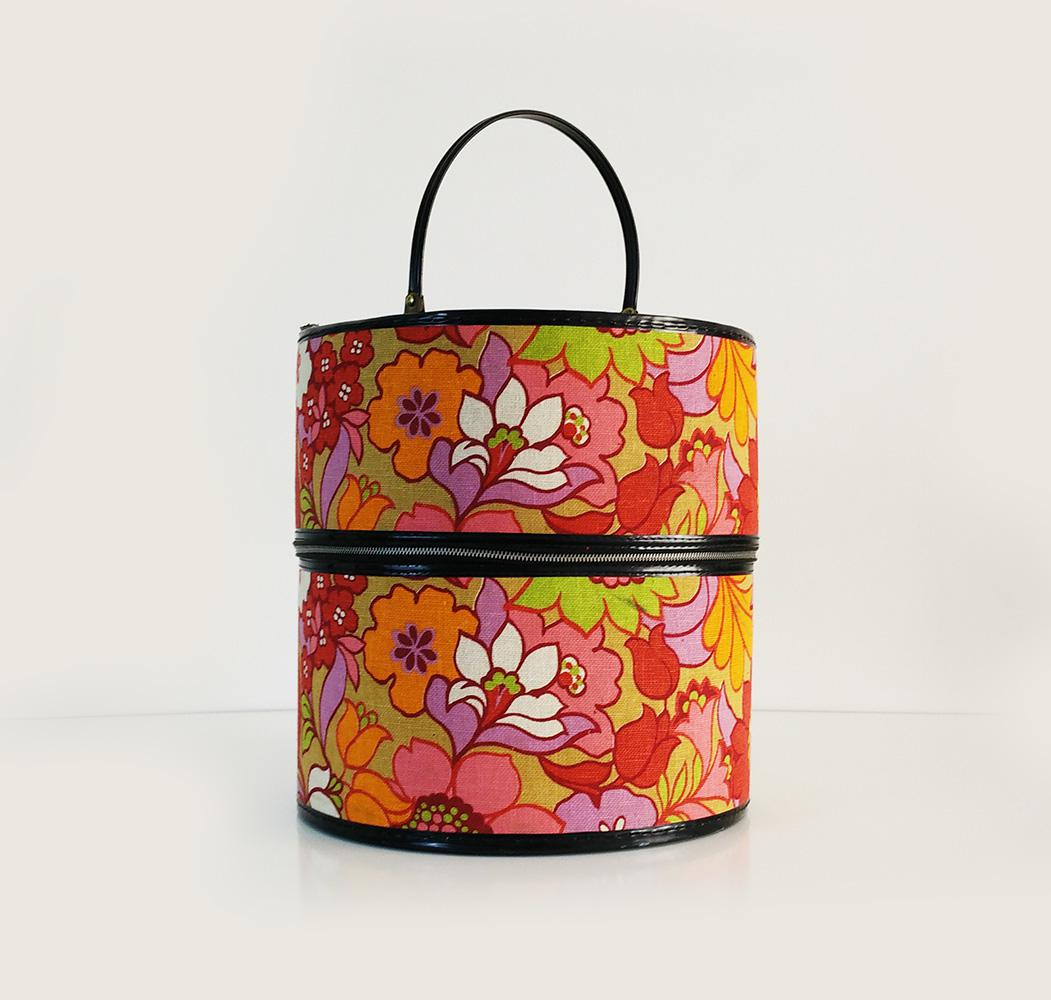 A Bright And Cheery Hat Storage Box. The Thick Fabric Covering The Sides Is  Adorned