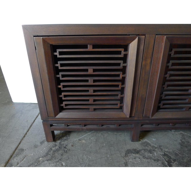 Vintage Walnut Three Door Cabinet with inset open wood screen panels. Newly refinished and restored in medium walnut or...
