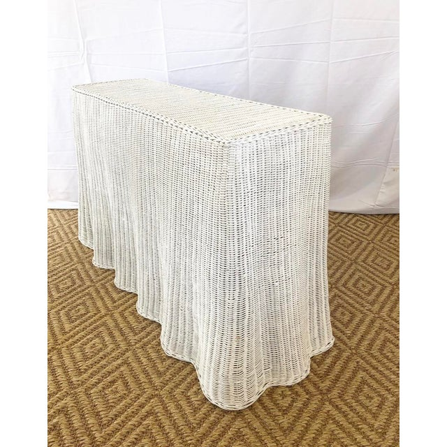 Vintage wicker console with draped design detail - originally natural wicker but had been painted white by the previous...