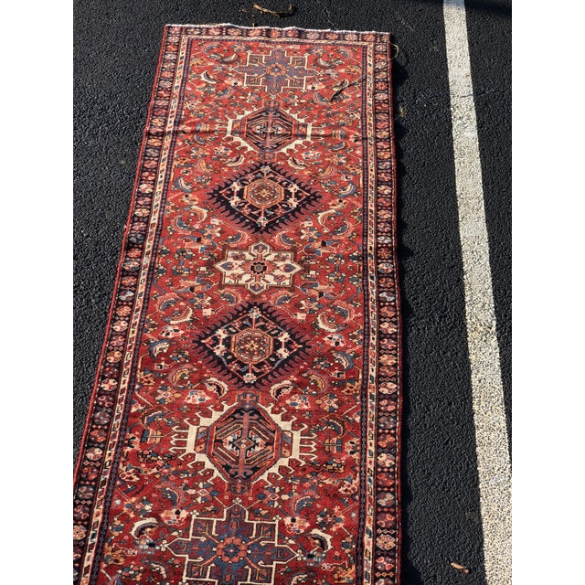 This is a vintage Persian runner. The piece is from the 1950s.