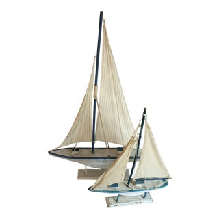 Pair of Decorator Carved Wood Sailboats With Fabric Sails For Sale