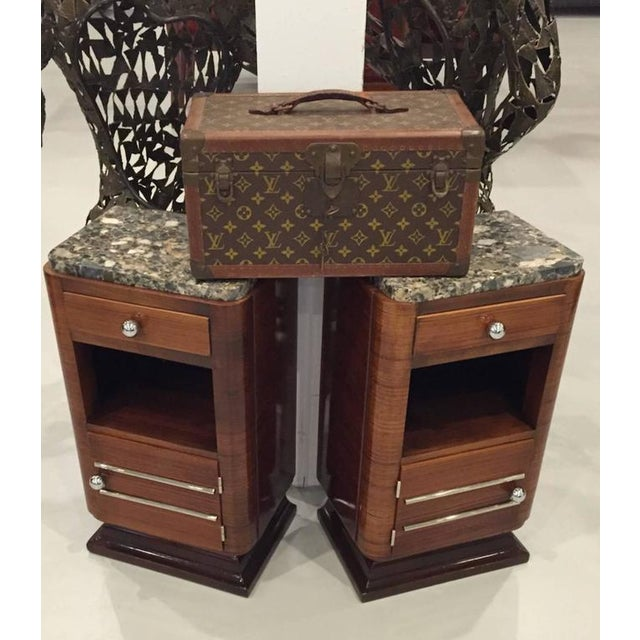 Pair of French Art Deco night stands with marble tops. Stunning chrome hardware that accents that wood beautifully....
