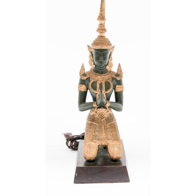 Bronze statue of a Thai Teppanom kneeling Angel Buddha made into a table lamp. Intricate bronze Thai Teppanom Kneeling...