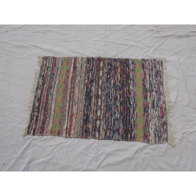 This is a antique hand woven Swedish oval Rag Rug. Lovely item for your home!