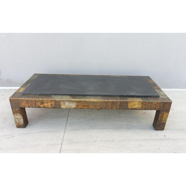 1970's directional Paul Evans patchwork coffee table with slate top sold as found previously owned without damage to the...