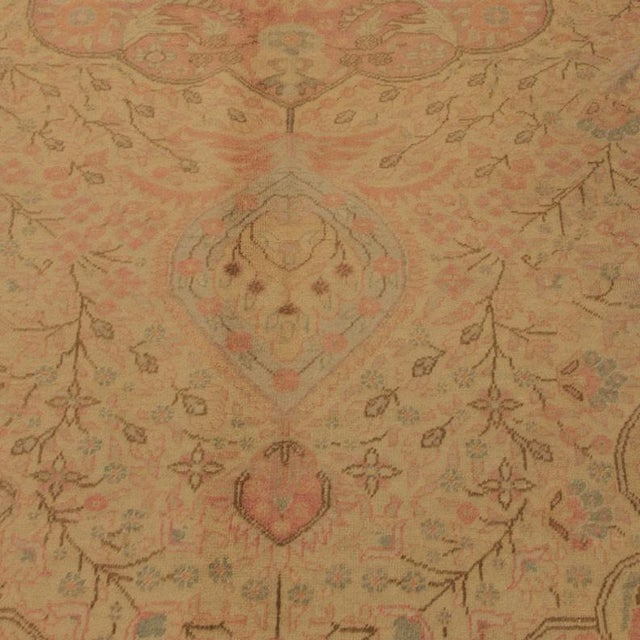 Antique hand-knotted sivas finely woven in turkey, this piece features extraordinary color. A happy piece with amazing...