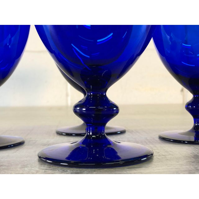 Vintage set of four cobalt glass goblets with a ball stem. No marks.