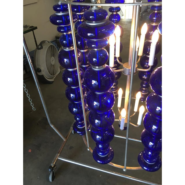 Modern stacked cobalt glass Chandelier featuring a round suspended nickel plated frame with a eight rows of custom made...