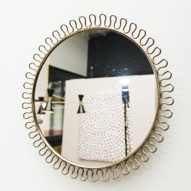 Brass wall mirror by Josef Frank for Svenskt Tenn, Sweden, 1950s.