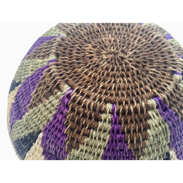 Native American polychrome seagrass and silk woven basket. Beautiful round shape with geometric designs woven into the...