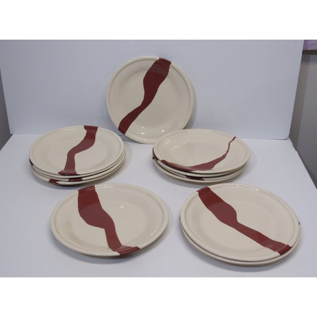 Inlaid Earthenware in natural terracotta and earth colors. The abstract pattern is different on each plate. Each plate is...