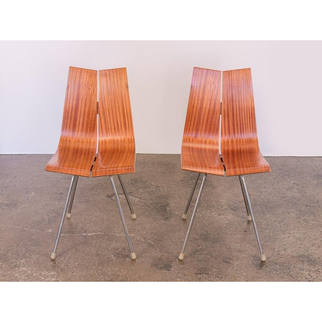 Pair of Hans Bellmann GA Dining Chairs for Horgen Glarus designed in 1955. Two parallel panels of moulded birch plywood...