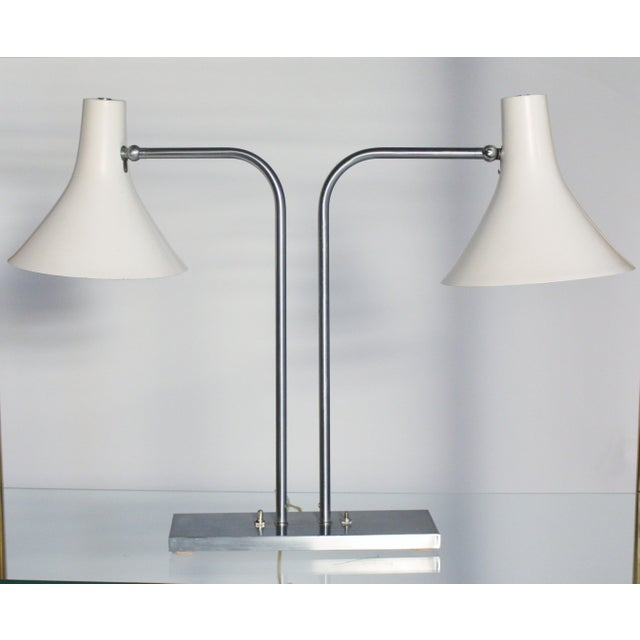 Iconic Mid-Century Modern desk lamp by Greta Von Nessen in sought-after two-shade swivel style and brushed nickel arms....