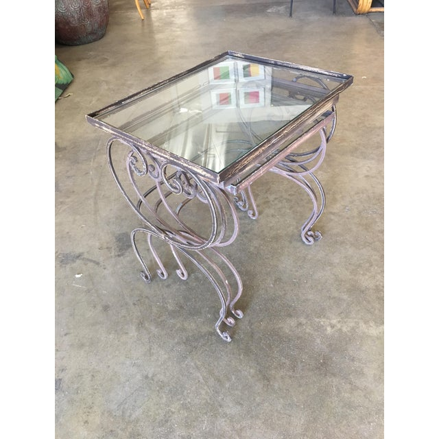Vintage 1990s outdoor/patio nesting side tables with painted steel scrolling base. Made in the US.
