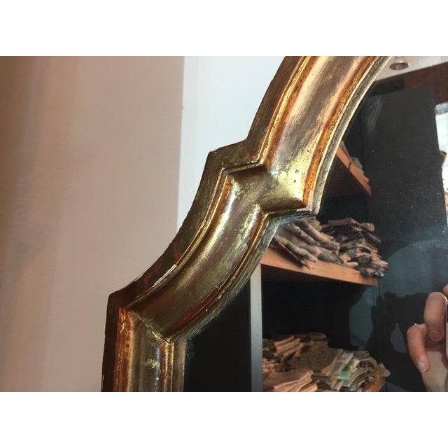 Beautiful gilded mirror from France with arched top, dates from the 19th century