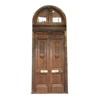 Antique Oak 13' Tall Exterior Carved Doors With Arched Transom and Frame For Sale