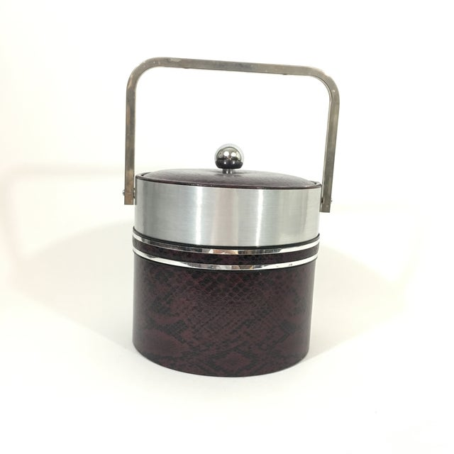 Vintage chrome and faux snakeskin ice bucket by Georges Briard. Faux snakeskin is a brown/ reddish color. Circa 1960's....
