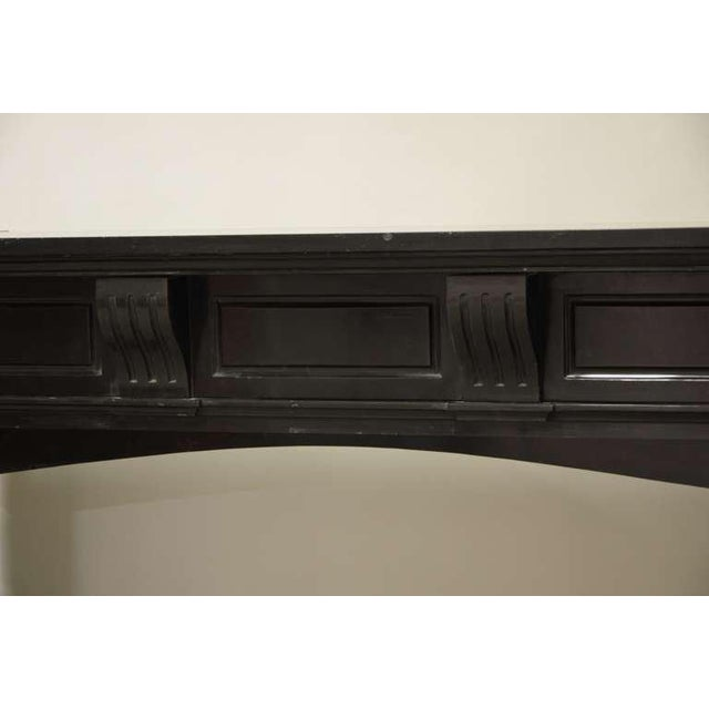 A late 19th century Dutch black marble fireplace. Opening measurements: 33.3 x 40.4 inch (height x width).