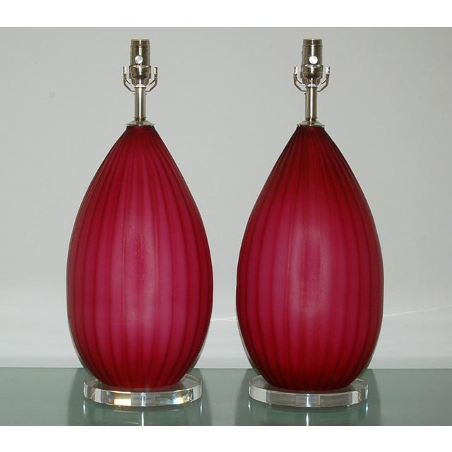 Chunky vintage Murano glass table lamps in magenta with vertical ribs. A very vibrant Venetian pair that will surely light...