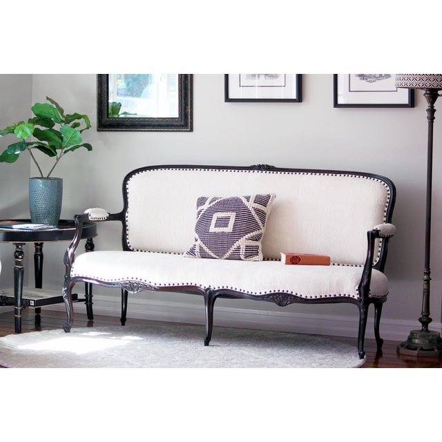 Gorgeous 19th century Victorian canape sofa in the French Rococo style, restored with a dark brown walnut stain and...