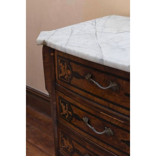 18th century Italian walnut veneered commode of serpentine and bombe shape, floral marquetry with white marble top.