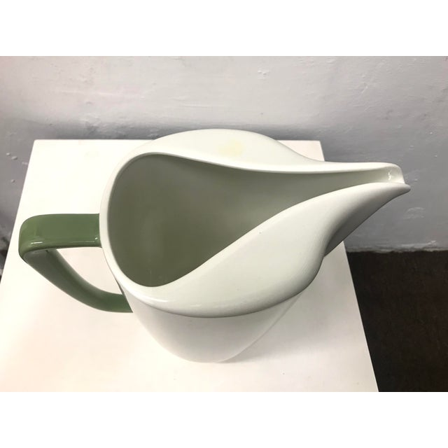"This large 50's mid-century ""Conversation"" pitcher by famed American industrial designer Walter Darwin Teague for Taylor..."