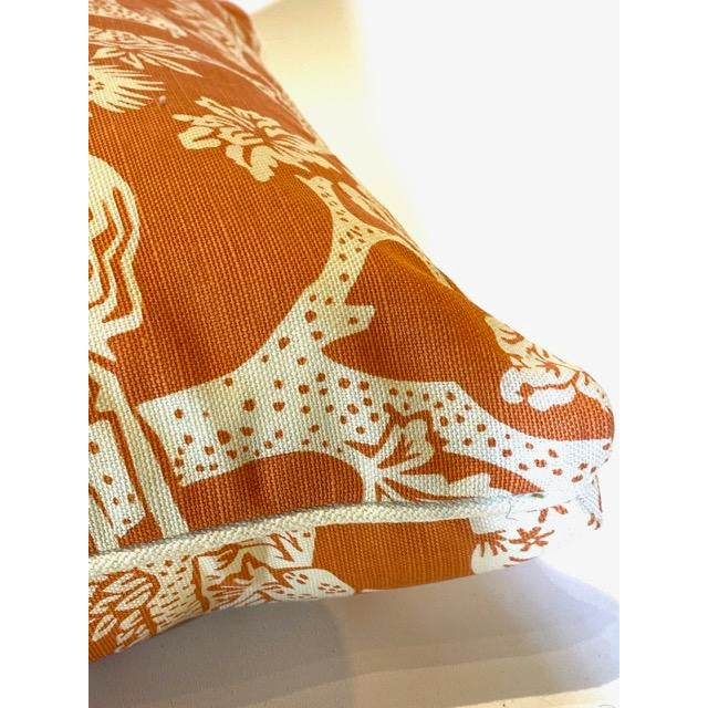 Quadrille Magic Garden print lumbar pillow (the scene is floral/tree-of-life/woodland); in a custom salmon. Quadrille...