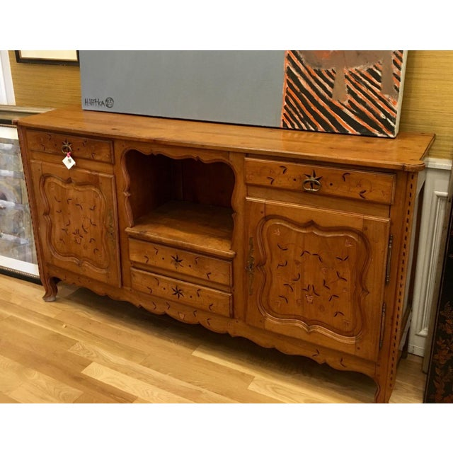 This lovely French country buffet is a genuine antique and dates to the 19th Century. It is a fine example in elegant...
