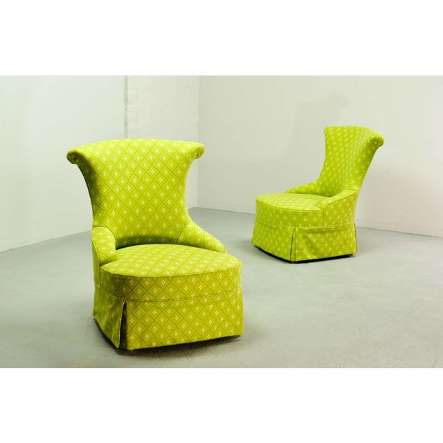 An exclusive pair of boudoir chairs in a bright lime colored high quality fabric. The refurbishment of the chairs is done...