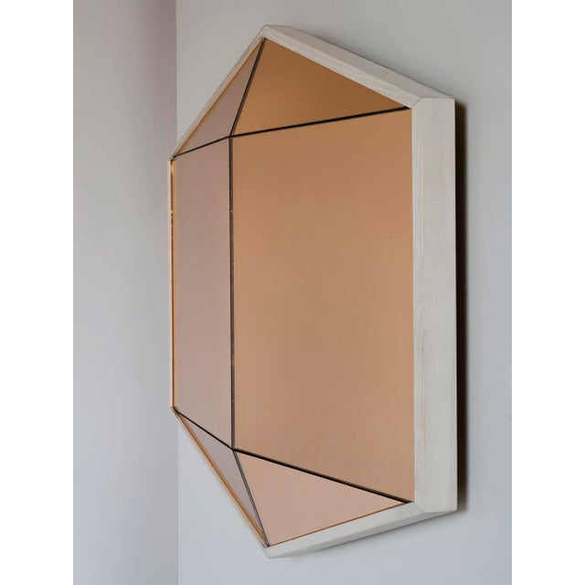 Built in colored mirror with a hardwood frame, the Gem Mirror offers a bold reflective surface. Six faceted panes of glass...