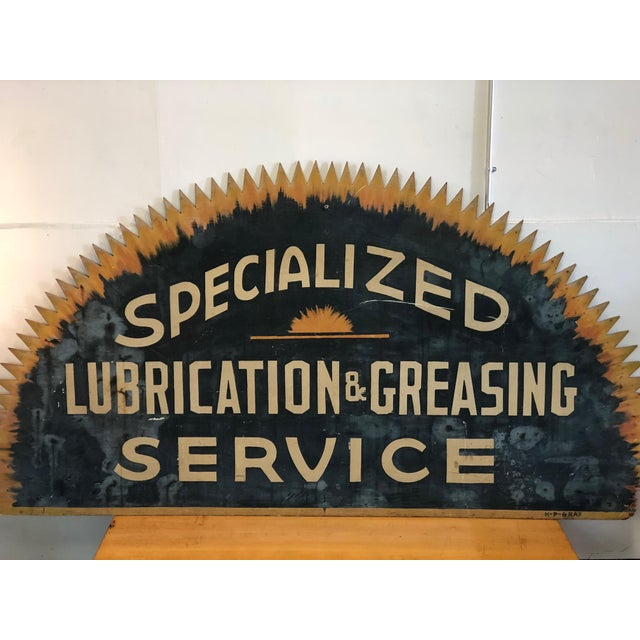Giant, vintage saw blade sign. 'Specialized Lubrication & Greasing Service'