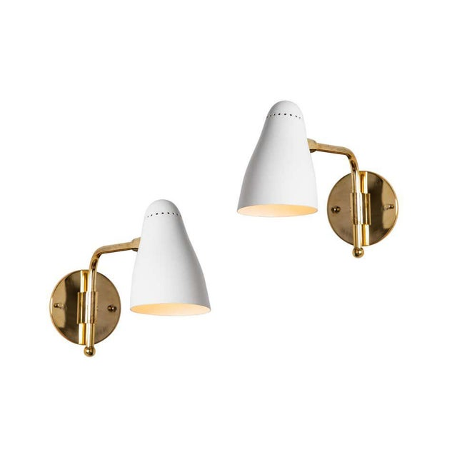 Pair of 1950s Giuseppe Ostuni articulating sconces for O-Luce. Executed in brass and white painted aluminum with...
